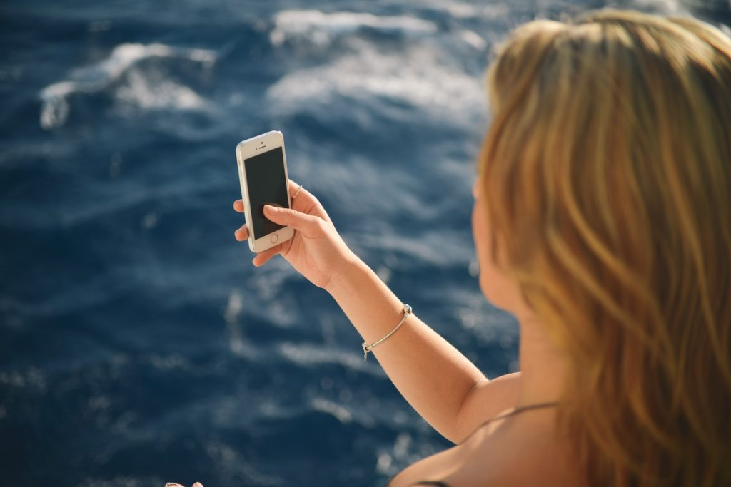woman-taking-picture-cruise-ship